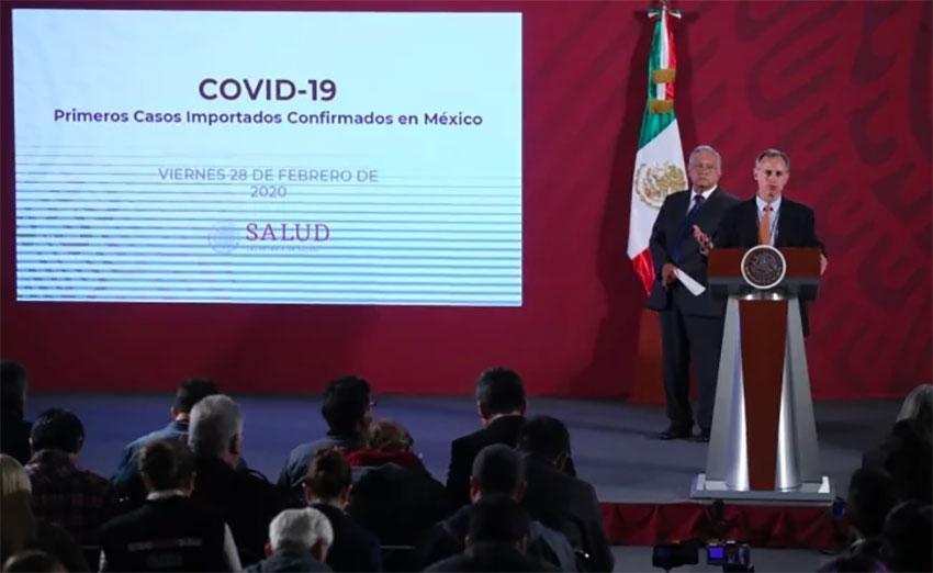 President López Obrador looks on as Deputy Health Minister López-Gatell announces the coronavirus cases.