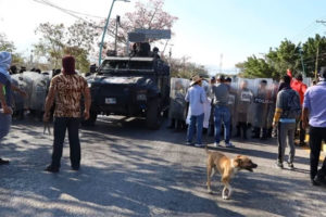 Police confront protesters in Chiapas.