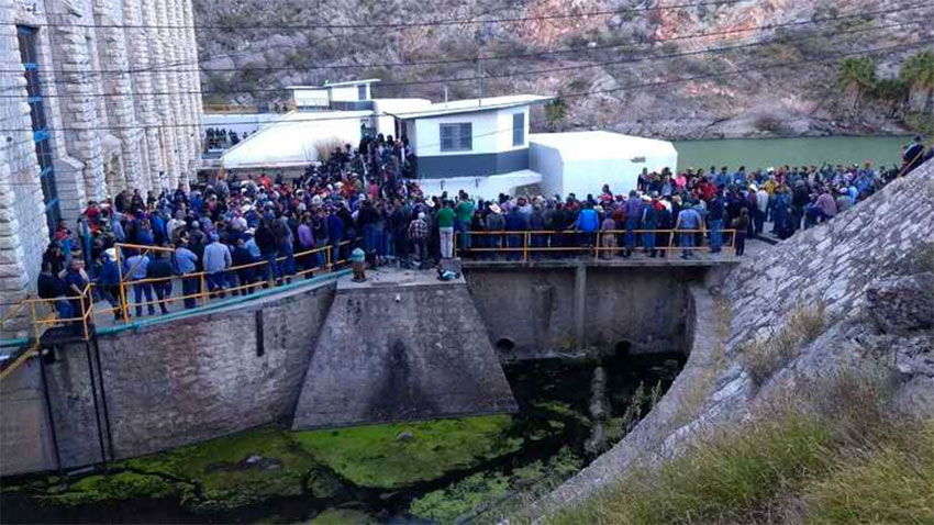 Farmers occupy the dam on Tuesday.