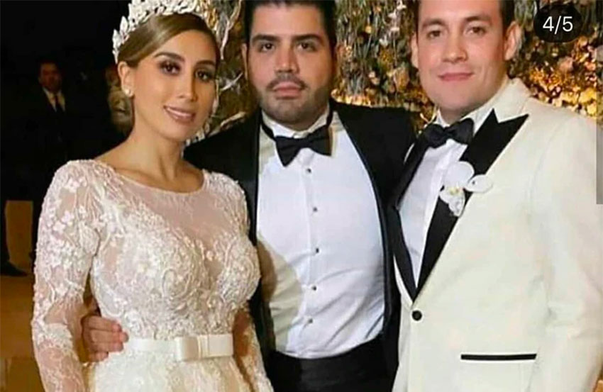 The groom, center, with El Chapo's daughter and a guest at the wedding in Culiacán.