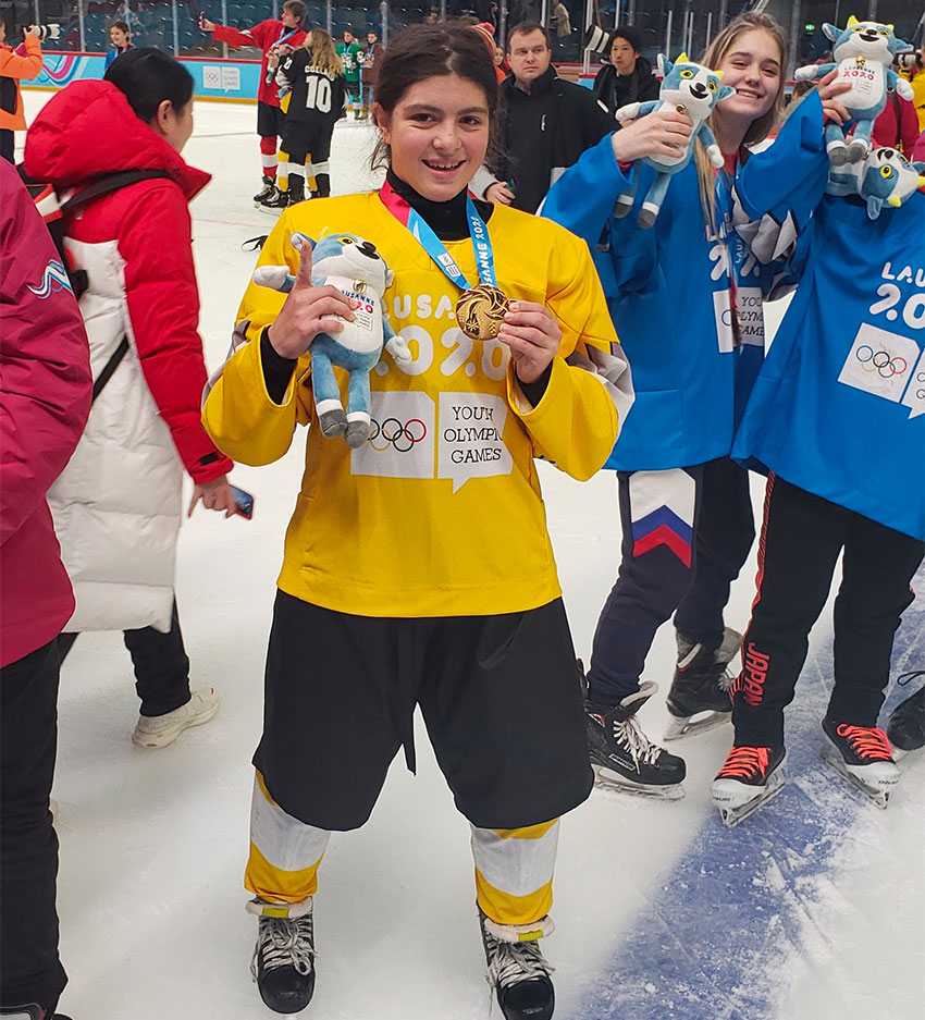 Hockey player Wilson with her gold medal.