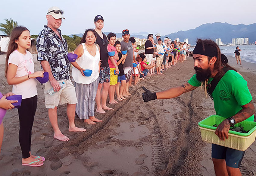 Last minute instructions are given to visitors at the turtle camp in Puerto Vallarta.