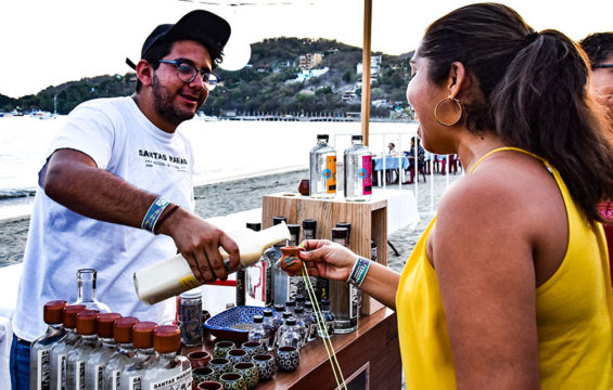 Sampling mezcal in Zihuatanejo.