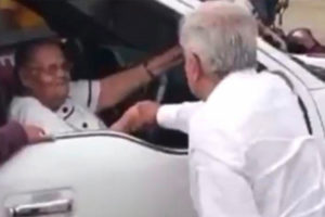 The president greets El Chapo's mother in Sinaloa on Sunday.