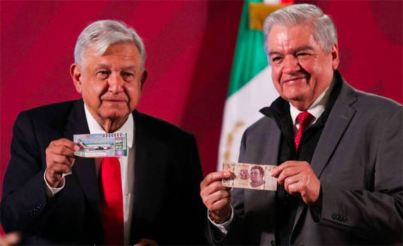 López Obrador, left, and lotteries chief Ernesto Prieto with raffle tickets.