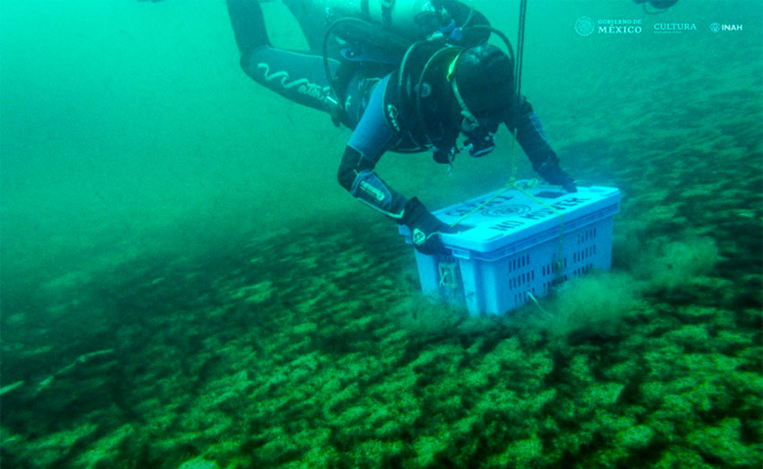 Underwater archaeologist Roberto Junco deposits the archive on the bottom of the Lake of the Moon.