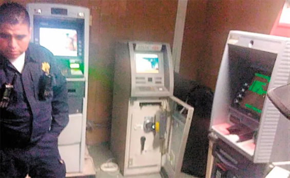 The 'doctors' had opened one ATM when an alarm sounded.