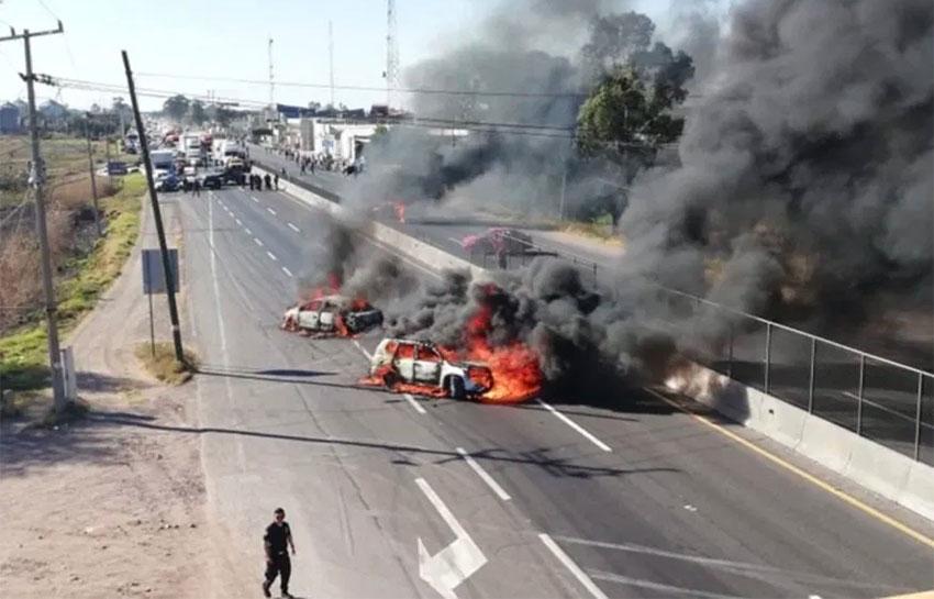 Vehicles burn in blockades on a Guanajuato highway.