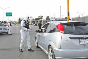 Police hand out informational brochures at the border in Ciudad Juárez.