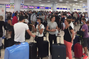Lineups at Cancún airport as travelers attempt to flee.
