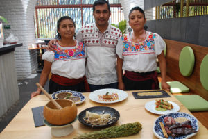 Irad Santacruz and two cooks from the Guardianas de la Tierra de Maíz at El Mexicano Masaryk