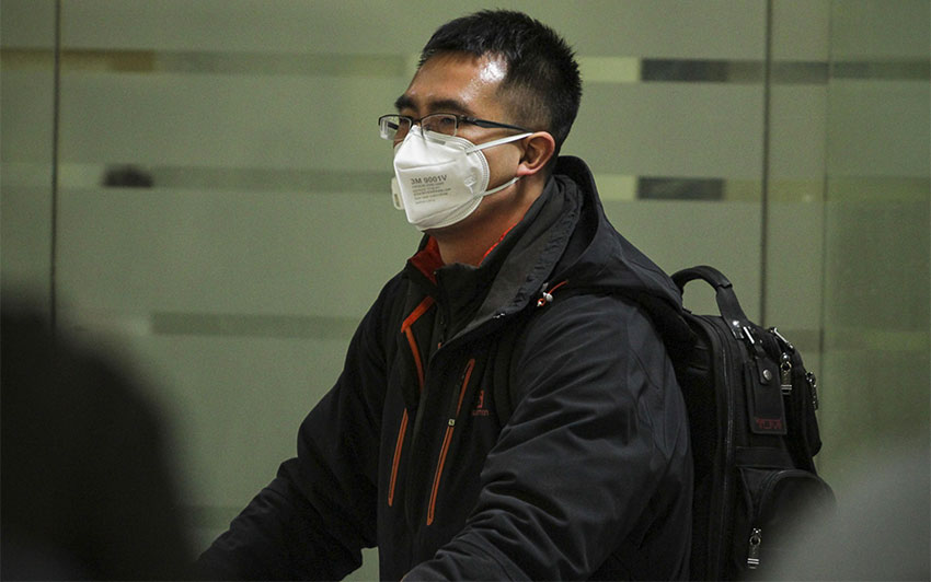 Travelers with face masks have become a common sight at Mexico City airport.