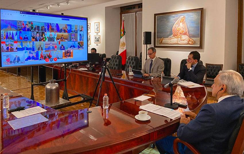 The president and other officials during the G20 video conference.