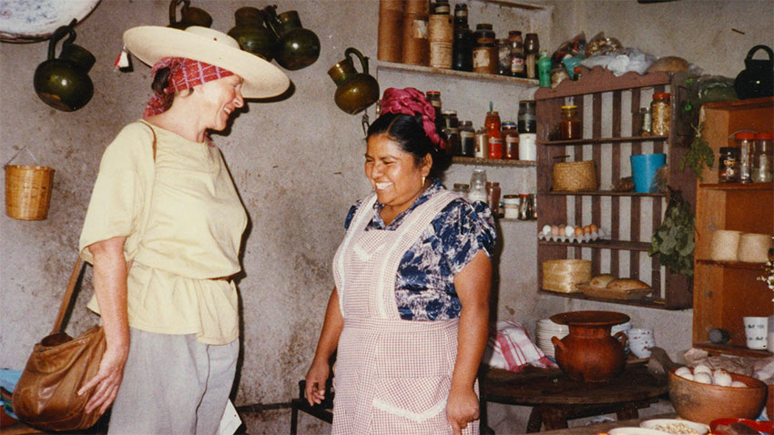 An early photo of Mexican cuisine expert Diana Kennedy with a traditional cook.