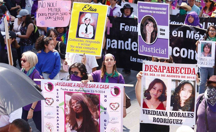Placards bore photos of missing and murdered women.