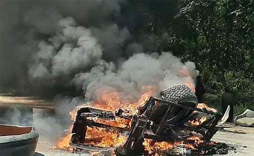 Migrants' belongings burn in Palenque, Chiapas.