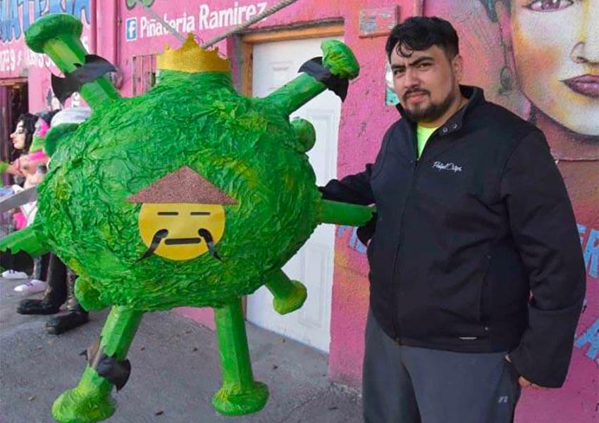 Ramírez and his coronavirus piñata.