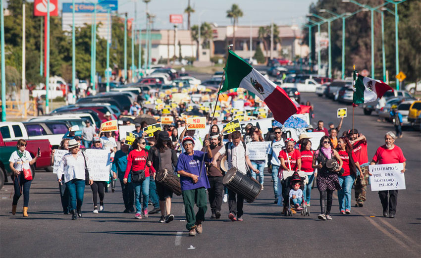 Protesters march last year in protest against the Mexicali brewery.