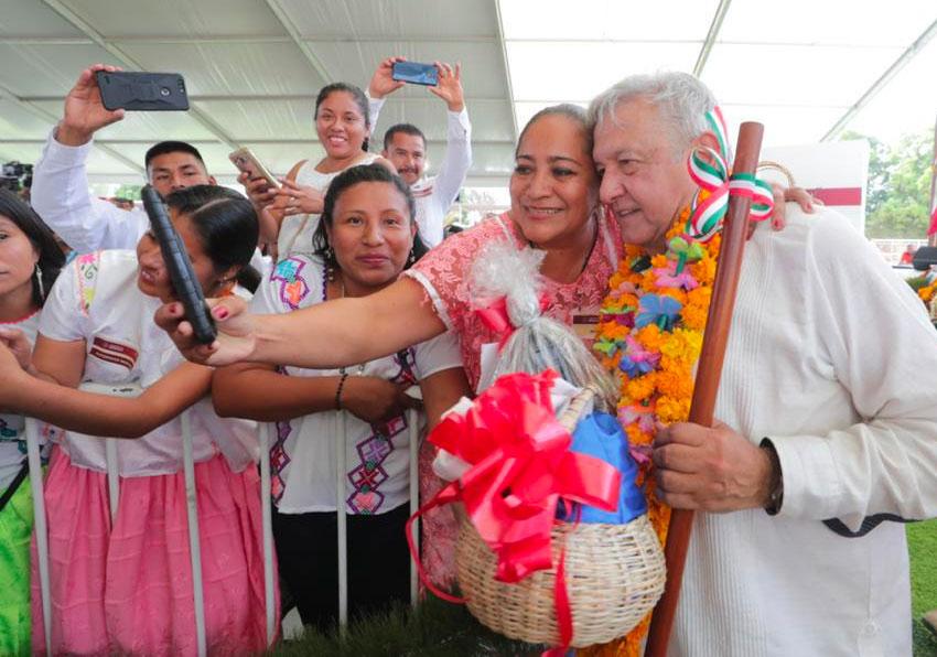 AMLO hugs a fan in Guerrero.