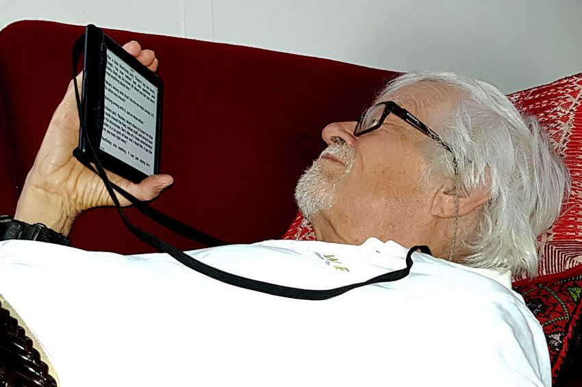 Attach a loop to your e-reader and there'll be no problem if you fall asleep.