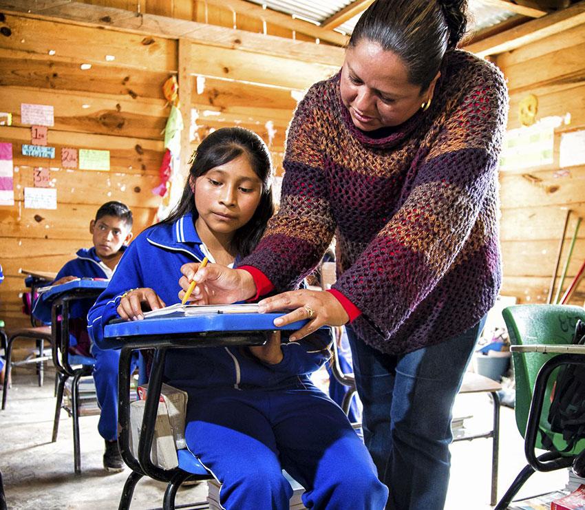 A REACH program student and teacher in Chiapas.