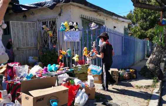 Alexis and his toys outside his Tijuana home.