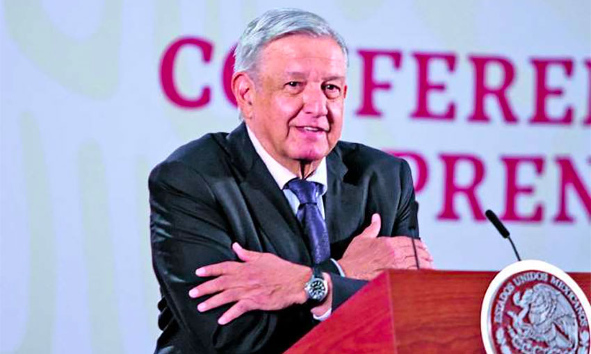 AMLO offers a hug to reporters at his daily press conference.