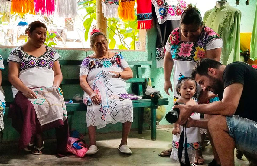 Filmmaker Manos Mitikas while filming Mayan seamstresses in Quintana Roo.