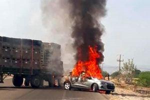 A vehicle burns Tuesday in a Guanajuato roadblock.