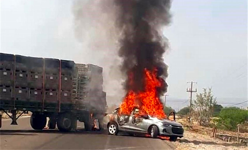 A vehicle burns Tuesday in a Guanajuato roadblock.