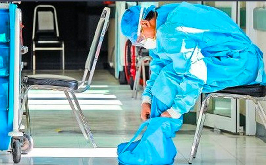 A healthcare worker in Toluca, México state, suits up with protective gear.