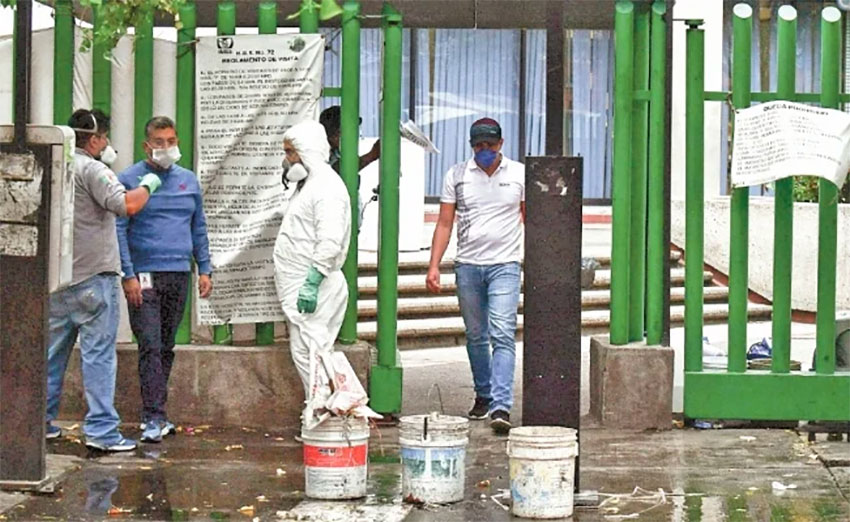 Workers disinfect the hospital in Tlalnepantla on Wednesday.