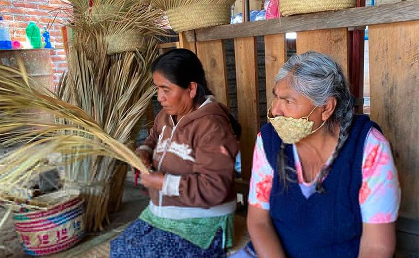 An artisan in Oaxaca wears one of the face masks made from palm leaves.