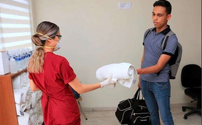 Nurse Iván Portillo moves into new digs after he was evicted.