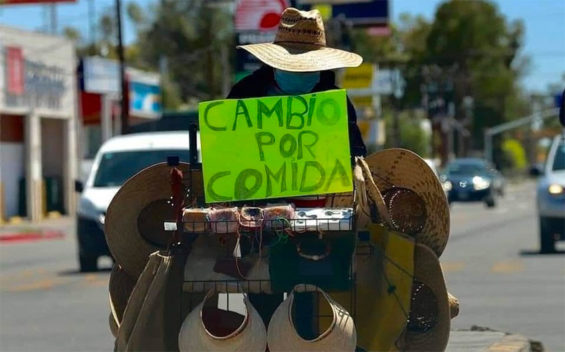'Exchange for food,' reads street vendor Margarita's sign in Los Cabos.