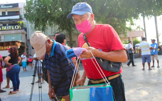 Amadeo Vidal sells masks on the street in Acapulco.
