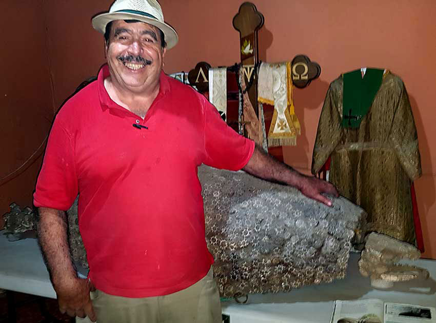 Gabriel Michel — and his winning smile — with glyptodont and vestments at his Jalisco museum.