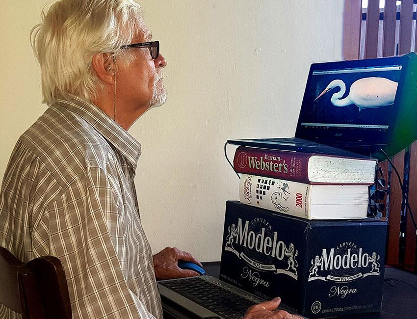 Raise laptop to eye level and use external keyboard.