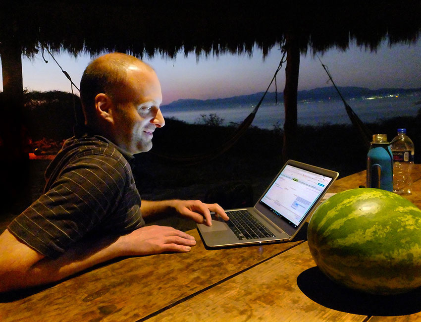 Laptops are fine for vacations, but long hours of use can cause back pain.