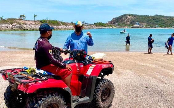 A lifeguard patrols a beach in Mazatlán.