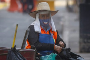 Dressed for the coronavirus, a cleaner wears a 'smile.'