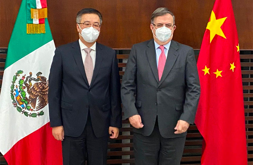 The Chinese ambassador, left and Ebrard.