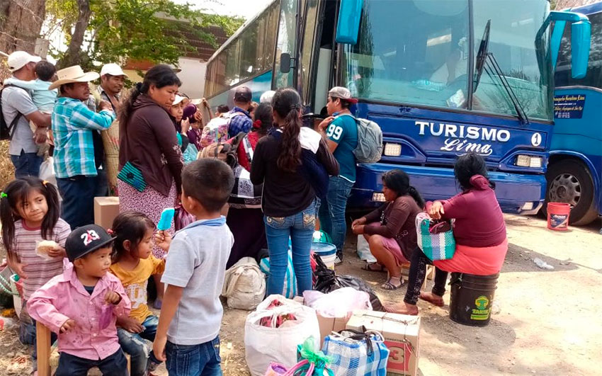 Workers wait to board northbound buses in Guerrero.