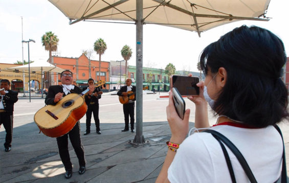 A woman live-streams mariachis in Mexico City for her mother, quarantined at home.