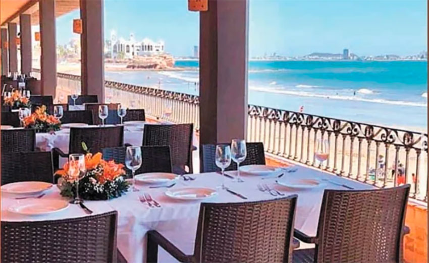 An empty restaurant in Mazatlán. The mayor wants to fill those seats for Mother's Day on Sunday.