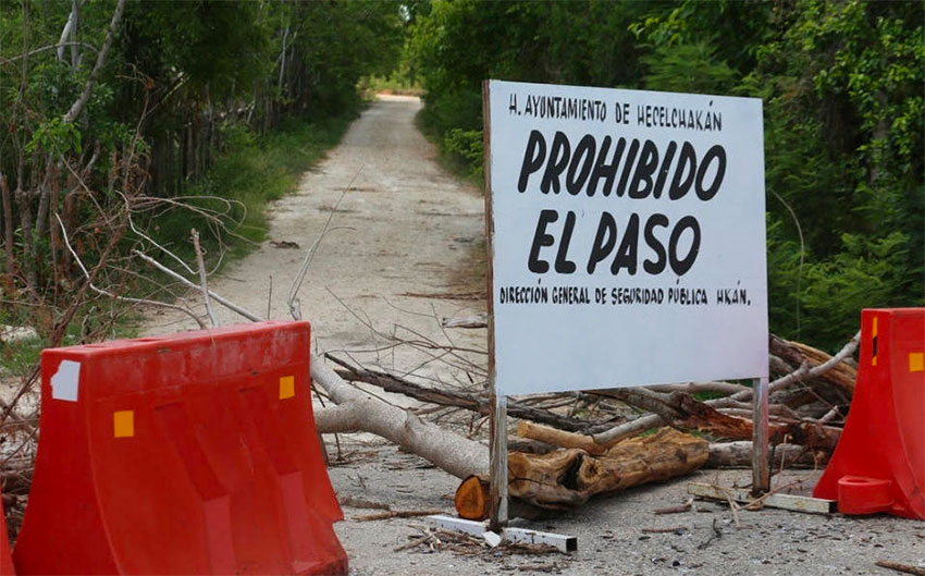 'Do not enter,' reads the sign outside Hecelchakán, Campeche.