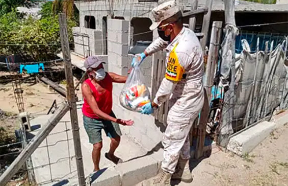 Both soldiers and sicarios distribute care packages in Mexico.