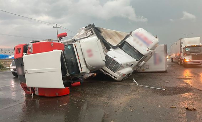 The wreckage of tractor-trailers after Friday's tornado.