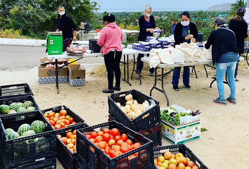 The Pescadero Food Bank prepares food packages for needy families.