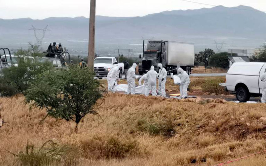 Forensic workers where bodies were found Friday morning.